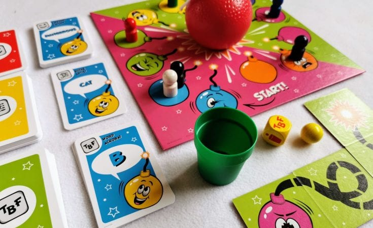 Pass the bomb board game - showing the cup, bomb, board and playing cards