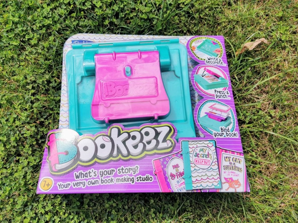 John Adams Bookeez set on grass. Bookeez helps children make their own book by binding and creating a front page