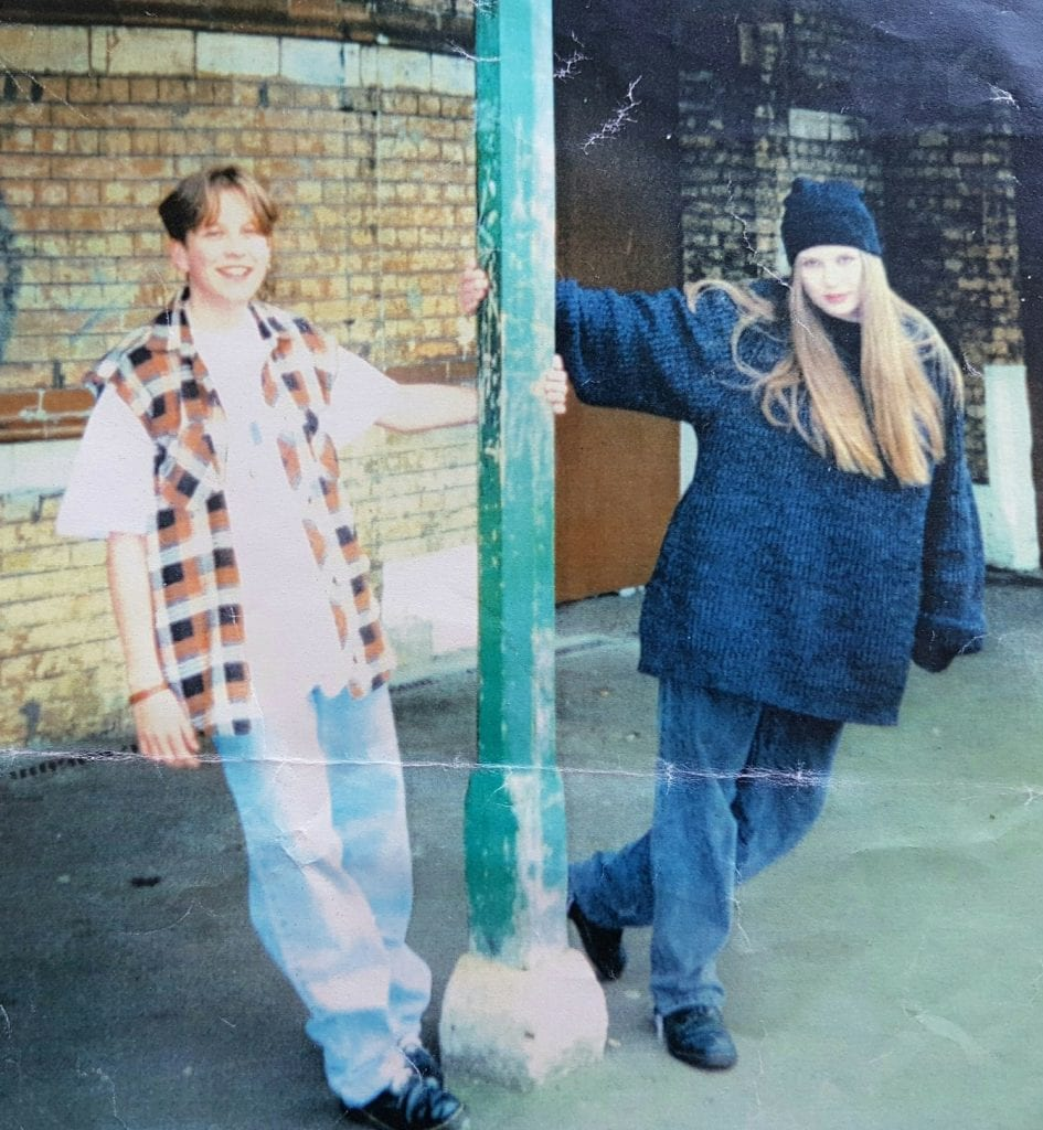 "Two young women at a train station circa 1994. Dressed in ""grunge"" clothes, Dr Martens etc"