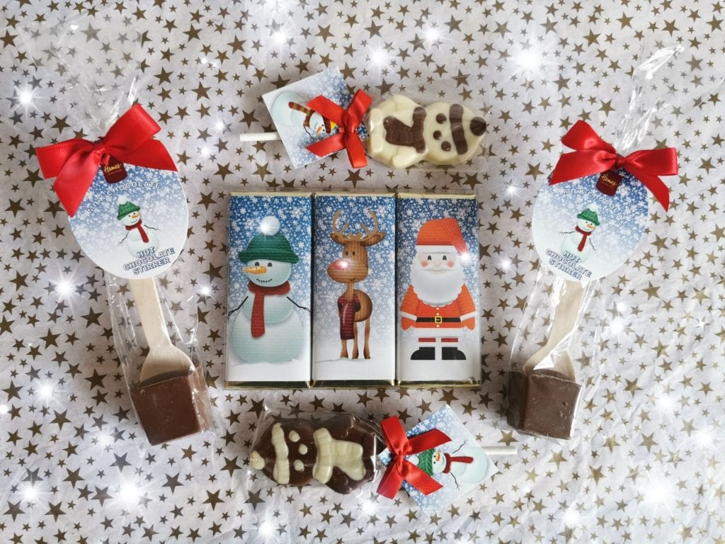Hames hamper. Set of chocolates, including hot choc stirrers, snowman chocolate lollies and three chocolate bars with Chrstmas characters on - snowman, rudolph and Father Christmas