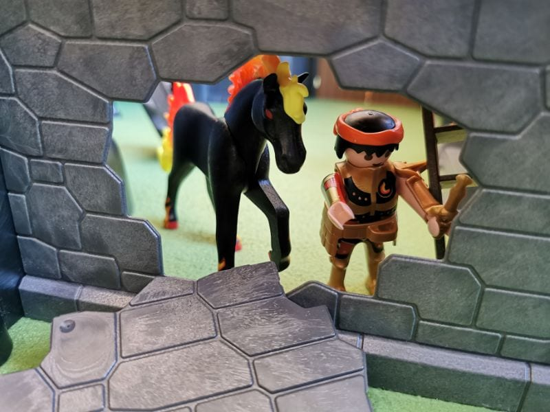 Playmobil Burnham Raiders Fortress: Showing the broken wall, character with horse with flames for tail and mane