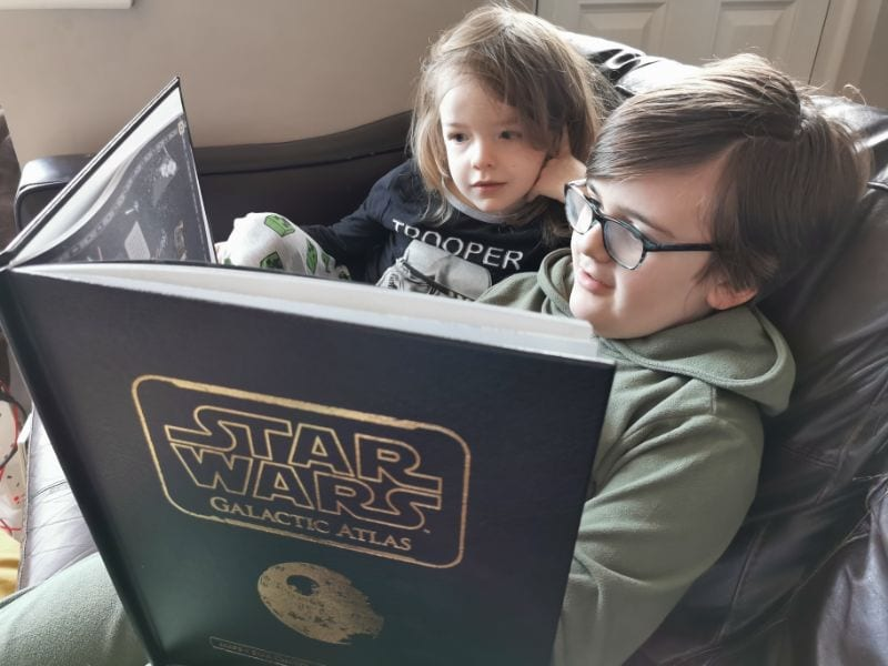 Star Wars Galactic Atlas being read by Big & Little L, two boys sitting on a sofa together