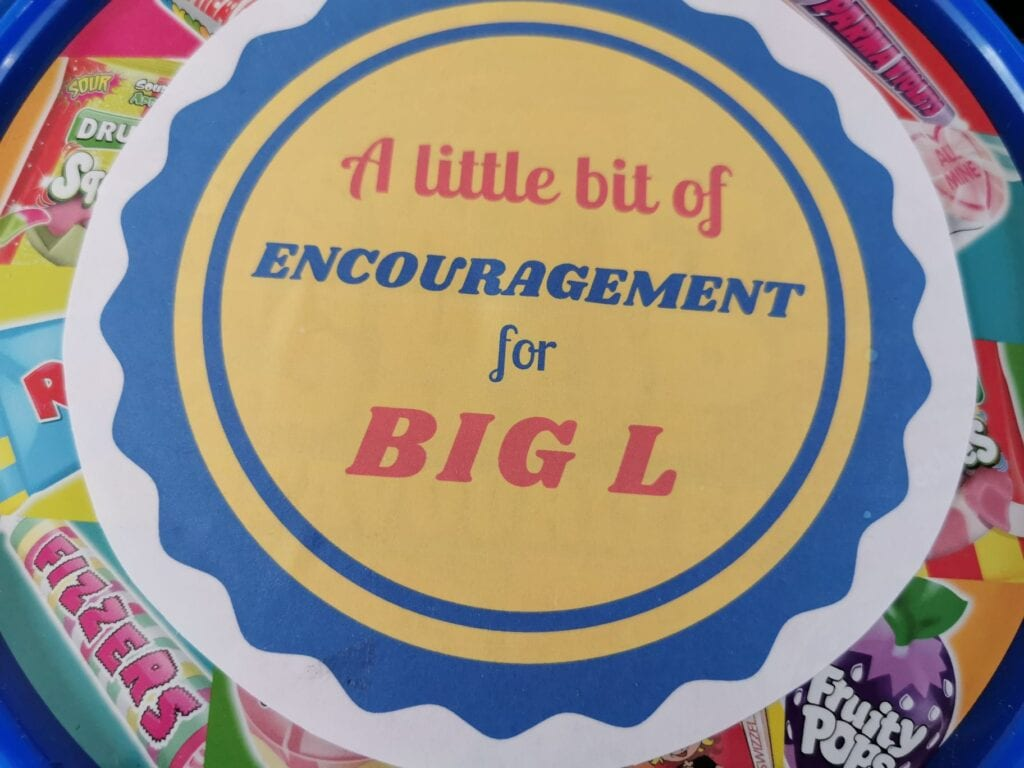 "Tip of Swizzels Sweet Shop Favourites tub with a sign ""A little bit of encouragement for Big L"""