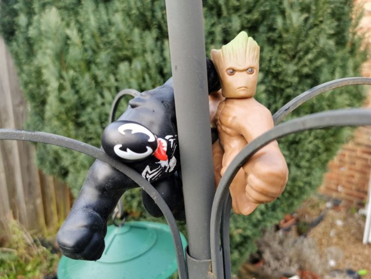 Venom & Groot Goo Jit Zu are holding on to a bird feeder