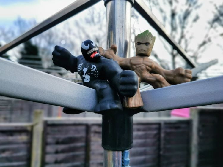 Venom & Groot marvel Heroes of Goo Jit Zu hang out on a washing line