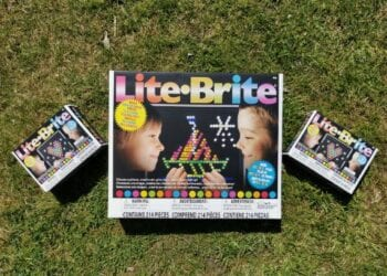 Lite Brite Classic and Mini in their boxes, side by side on grass