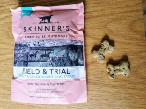 First dog essentials: Packet of Skinners dog treats and two bone-shaped treats